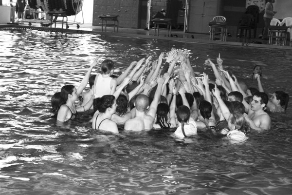 Great Falls swimmer celebrate the CMR girls fourth consecutive state title.