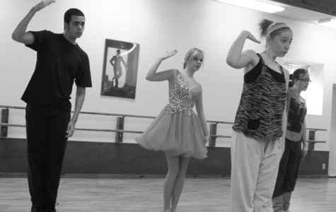 Senior Sarah Howard, right, works with a class at Miss Linda's dance studio.