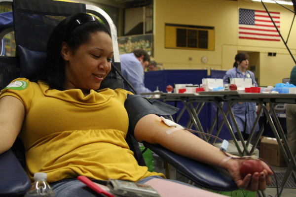 Senior Lauren Dinkins donates blood at the April 12 Red Cross Blood Drive at CMR.