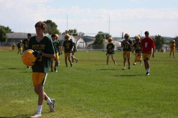 Rustler+football+players+leave+the+field+following+an+Aug.+15+morning+practice.