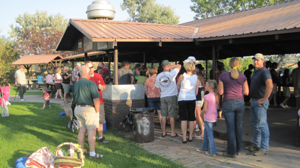 CMR+staff+and+family+members+wait+in+the+food+line+at+the+Sept.+7+picnic+in+Black+Eagle.