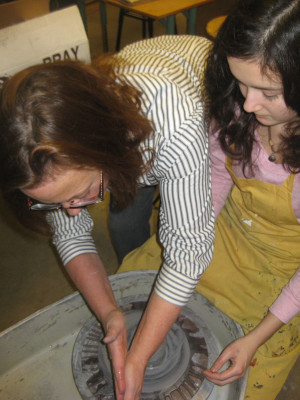 Teacher Tess Jacobs and junior Maggie Hodges collaborate on a pottery project.
