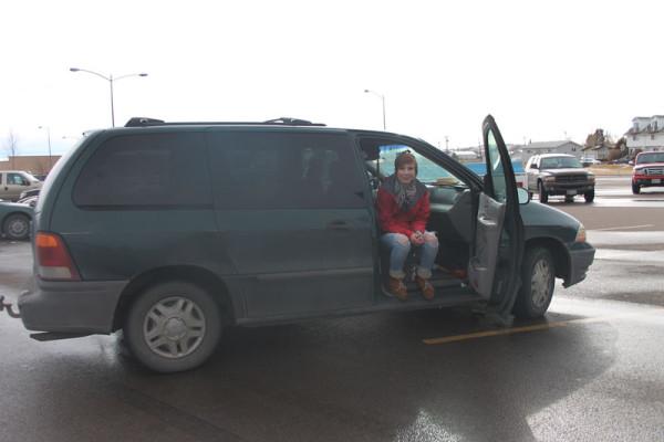 Kasey Volkmar sits with her beloved van, Edwardo in the CMR parking lot.