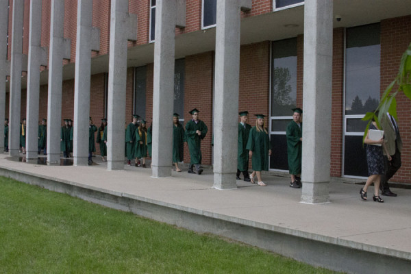 The+Class+of+2013+makes+its+way+to+the+CMR+Fieldhouse+June+1+for+the+graduation+ceremony.