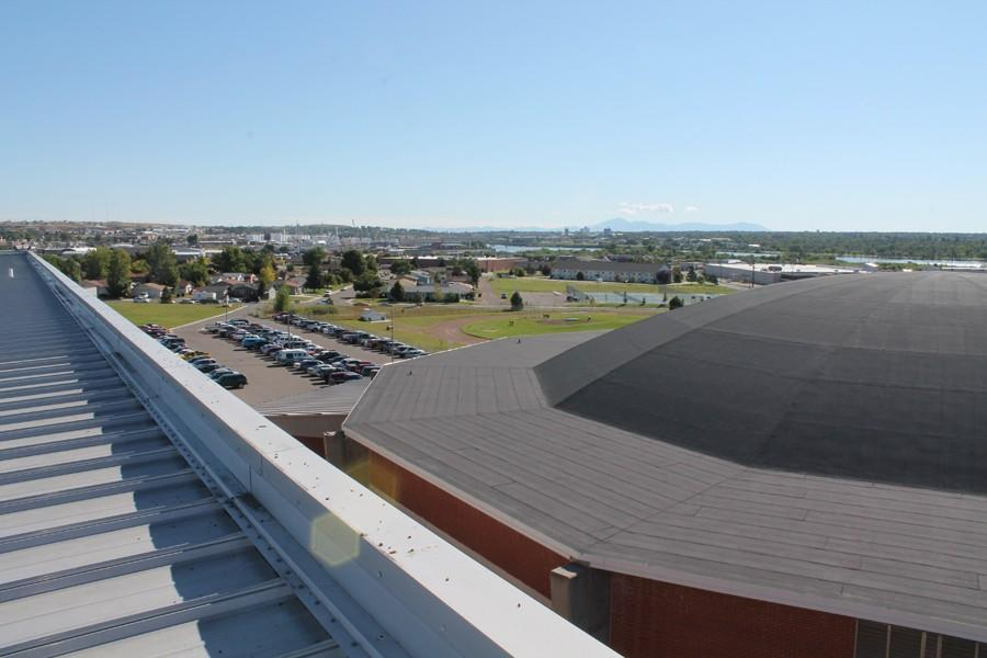 The+fieldhouse+roof+and+part+of+the+campus+is+visible+from+the+roof+of+the+main+building.