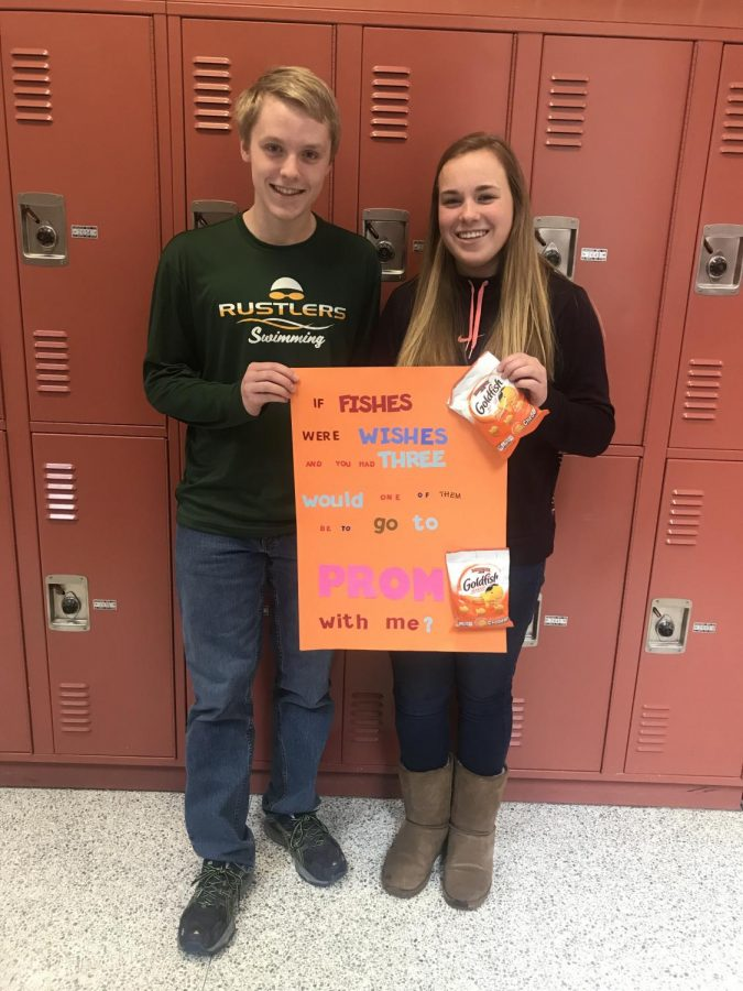 Swimming together for years, Alex Houston gathers his courage and asks fellow swimmer Maddie Carroll to prom. Knowing she loves the iconic Goldfish cracker, he created a sign specific for her. Excitedly, she says of course.