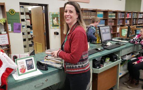 Librarian watches newspaper methods change