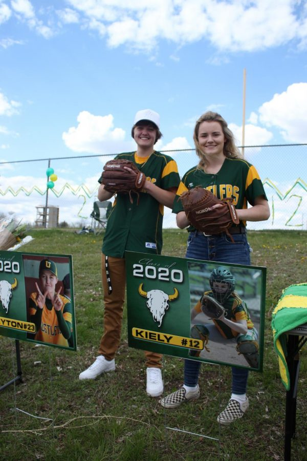 CMR seniors Peyton Peterson and Kiely Gunderson celebrate their years on the softball team on May 14.