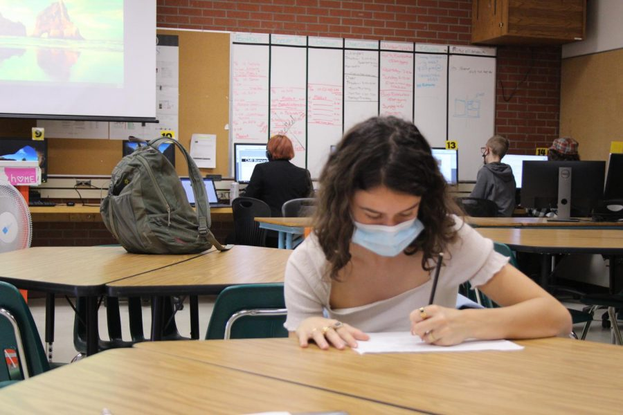 Lucie Michel of France prepares for an interview during Newspaper Workshop on Oct. 8.