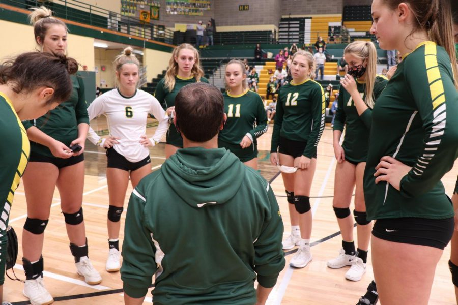 Head coach Patrick Hiller offers encouragement to his team during a timeout Sept. 19. The Rustlers defeated the Gallatin Raptors.