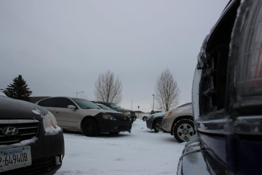 Snow blankets students' cars