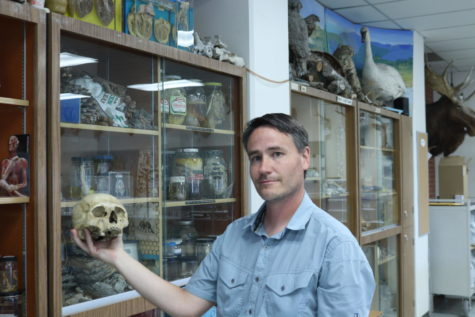 Nathan Gregier stands with skull.